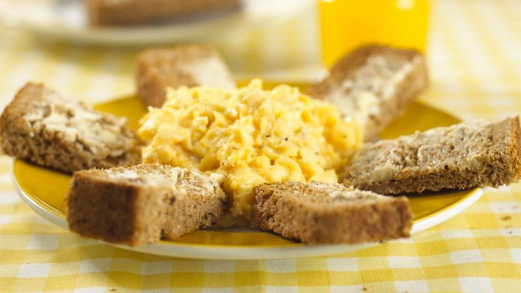 Annabel Karmel's cheesy scrambled eggs with soldiers
