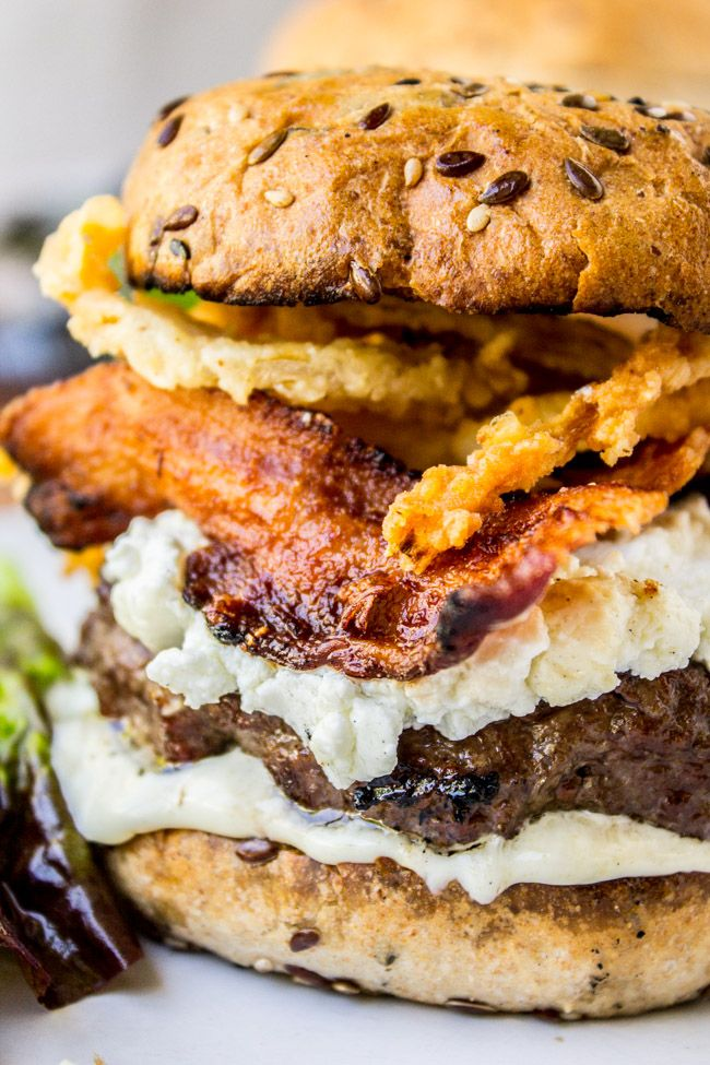 Bacon and Goat Cheese Aioli Burger with Crispy Onions!  A juicy burger topped with goat cheese, then paired with bacon, lemon aioli, crispy onion strings, and a killer bun. Perfect for Father's Day or any summer grilling get-togethers!