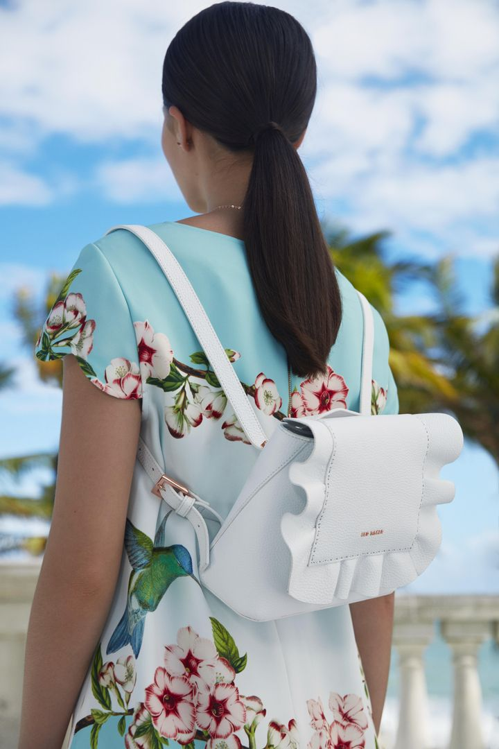 ec97a698acb7c0 Go hands-free in style with the innovative RAMMIRA bag. Crafted from top  grain