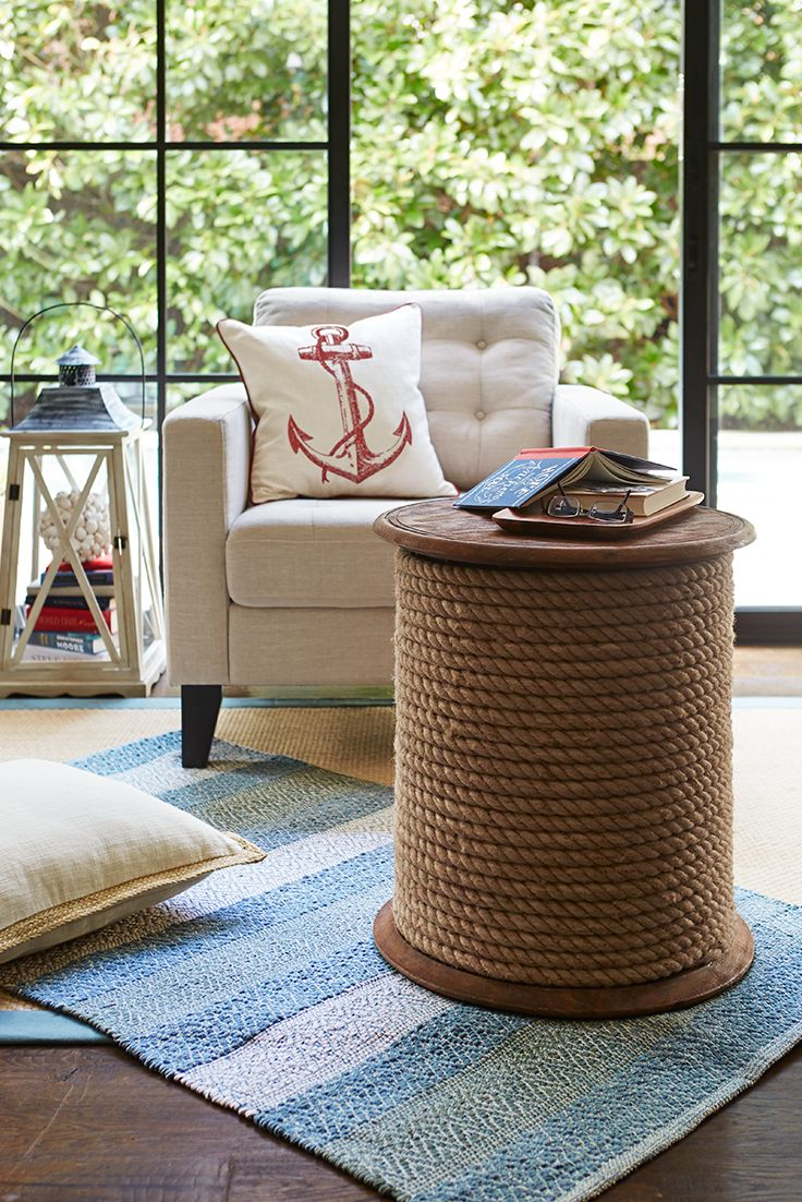 A unique accent or drink table for home or beach house, Pier 1's nautically inspired Rope Accent Table is handcrafted of solid mango hardwood, finished in deep java and hand-wrapped in natural jute rope. The top border is hot-stamped by hand for a rustic touch, and the bottom is padded with felt to prevent floor damage.
