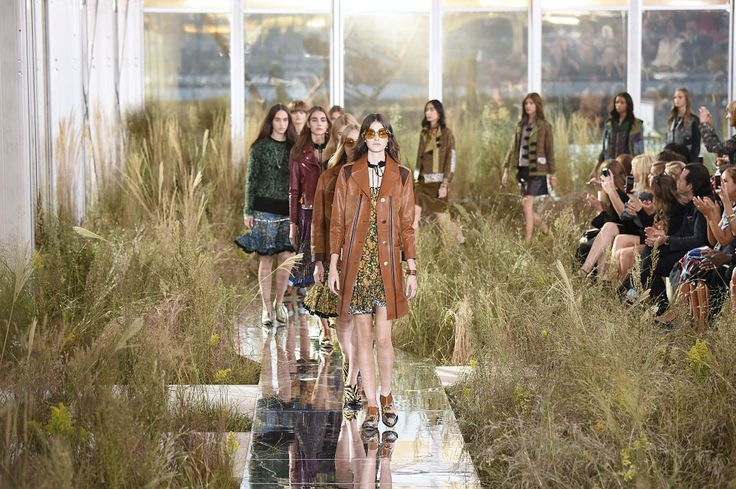 "Thought that overgrown fields were unfashionable? Allow Coach to prove you wrong. In this summery set from New York Fashion Week, the brand's natural leathers and organically hued fabrics are echoed by a bounty of wild grass. Note, however, that the models are strutting on a mirrored floor — a reminder that even a ""natural"" decor aesthetic can benefit from just a touch of shine."