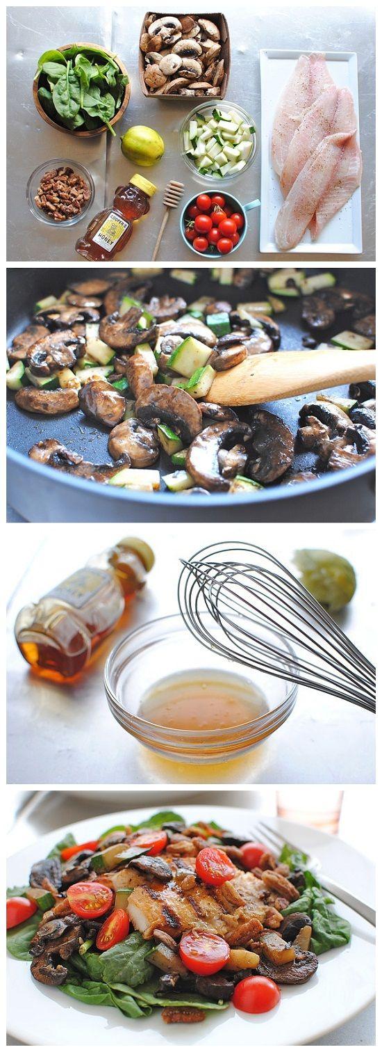 Gegrilde Tilapia Salade.  1 eetlepel extra vergine olijfolie  8 gesneden champignons  1 gesneden courgette  1 snuifje grof zout en versgemalen peper, plus meer voor het kruiden van vis  3 eetlepels honing  1 eetlepel verse limoensap  2 verse tilapia filets  3 kopjes baby spinazie  1 kopje cherrytomaten, gehalveerd  1/2 kop gesuikerde pecannoten  4 eetlepels favoriete gebotteld limoenvinaigrette
