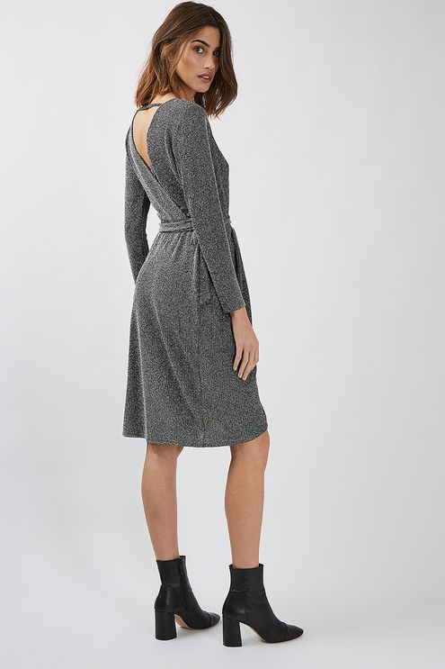 The most flattering style of the season, the wrap dress is seriously trending. This glitter tie wrap style in a gorgeous shimmery black and silver is proof - from its knee-length cut, practical long sleeves and v-neck detail. We love to team with strappy heels for a polished finish. #Topshop