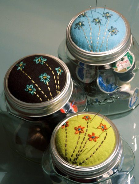 sewing kit in a jar with an adorable pincushion on top. :)