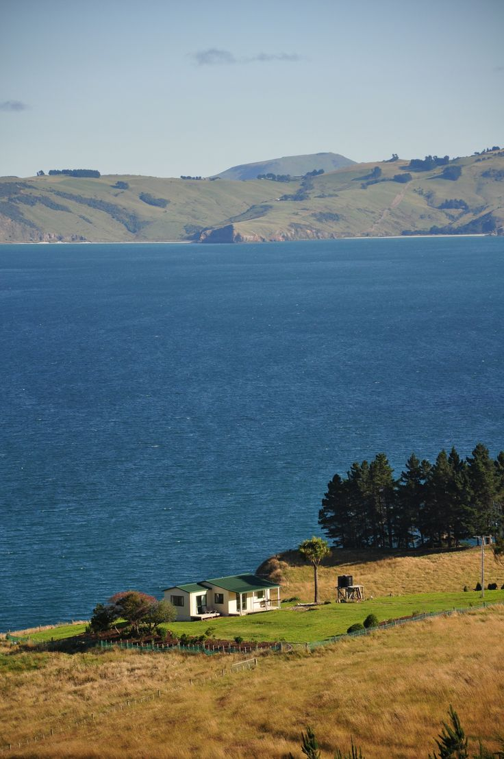 A bach is the Kiwi term for a vacation cottage, or a holiday home. A bach on the Otago peninsula near Dunedin, New Zealand