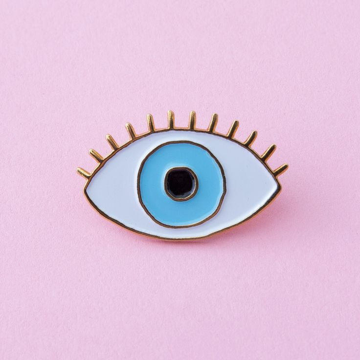 STYLE: Lucky Blue Eye keep at least one eye on the prize when you wear cou cou suzette's eye pin in the dreamiest shade of blue that's the color of a swimming pool on a summer day. couldn't you just d
