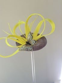 Grey button with fluorescent yellow loops and matching butterfly