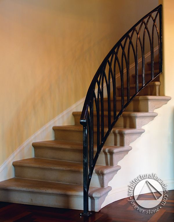 Beautiful staircase with cast stone stairtreads.