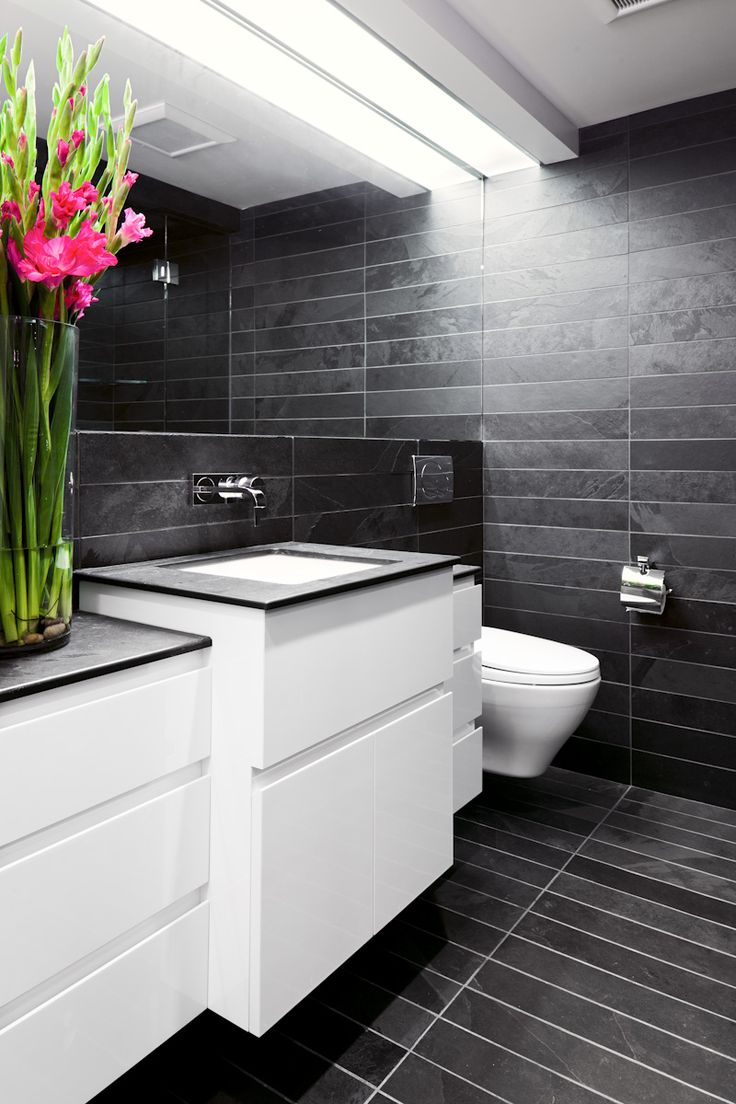 Contemporary floating monochrome bathroom unit with push open drawers. #monochrome #bathroom #storage Designed by // Natural Balance Premium Home Builders USA. More photos http://www.naturalbalancehomes.com/projects.htm?RD=1#dunbar