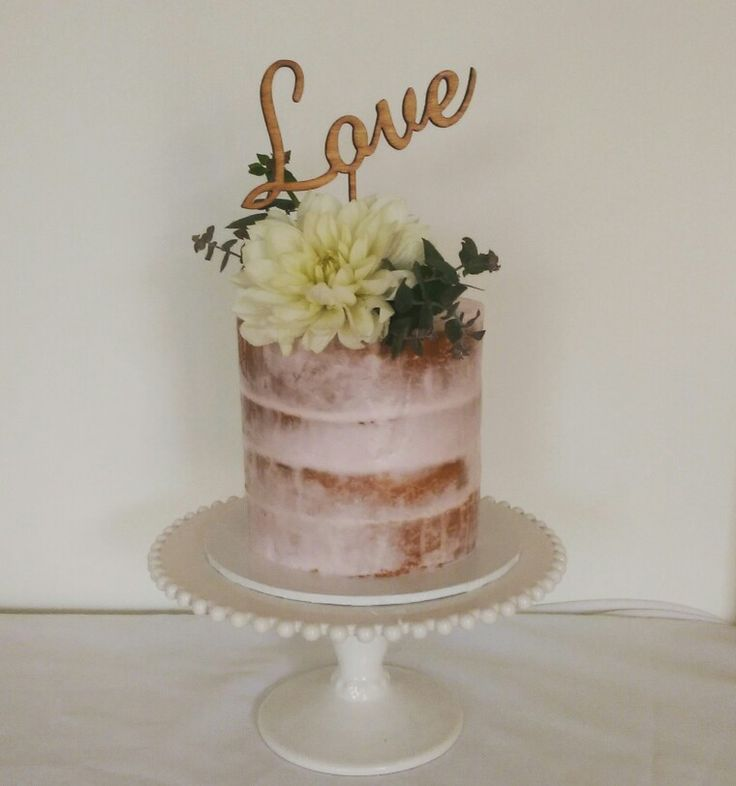 Semi Naked cake pink frosting fresh florals and Love topper