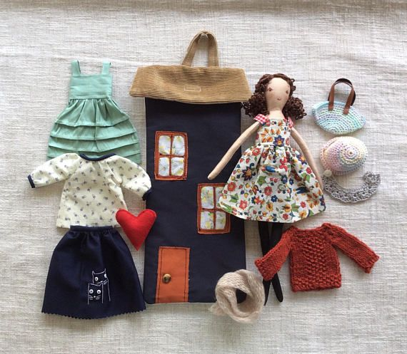 Monica lives in a house bag with all her clothes tucked away in the back of the bag. This catch-all bag is perfect to take along for long car rides or to playdates. She is a dress-up cloth doll made for active, quiet and imaginative play for children of all ages. Made in a pet free, smoke