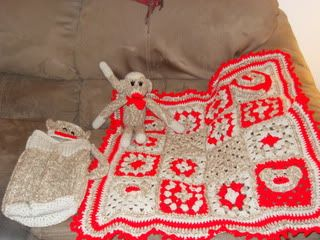 Crocheted Sock Monkey With Afghan, Cocoon, and Hat.