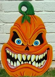 scary pumpkin wooden yard art