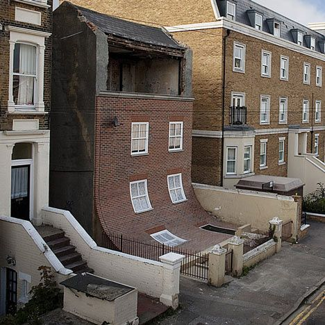 """British designer Alex Chinneck created an art installation - """" From the Knees of my Nose to the Belly of my Toes """" by removing the facade of a derelict 4-storey house & replacing it with a brand new frontage that leaves the crumbling top storey exposed, then curves outwards so the bottom section lies flat in front of the house."""