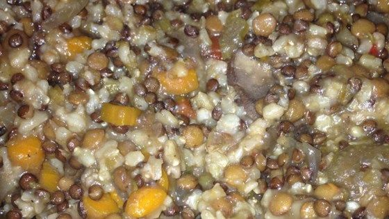 Dried lentils and uncooked brown rice are combined with vegetables, seasonings and broth in this easy and nutritious soup.  Chopped mushrooms are added in the last of the 8 hours of cooking time.