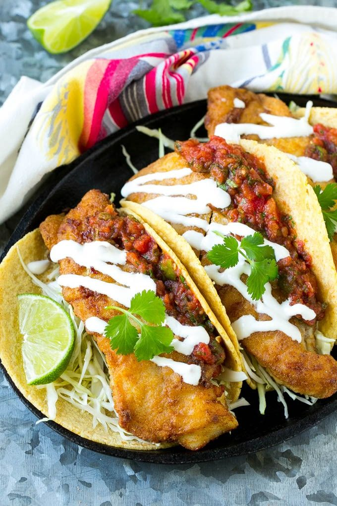 This recipe for Baja fish tacos is crispy fish fillets with cabbage, salsa and creamy sauce, all wrapped in warm corn tortillas. Just like you'd get in a restaurant, except better!