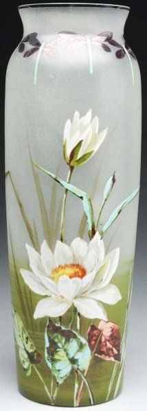 An extremely large vase with a hand painted Art Nouveau décor of dragonflies and water lilies. Circa 1900.