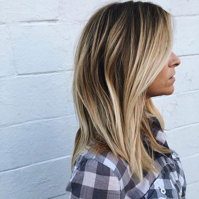 "Dimensional ""Bronde"" // This is the perfect color for blondes transitioning into fall/winter. It's a little bit of everything. Keep it bright around the face so you don't feel drab, and a subtle root shade for a lived in vibe. Low low maintenance hair color! #joeyedwardssalon #hairbyjoey"