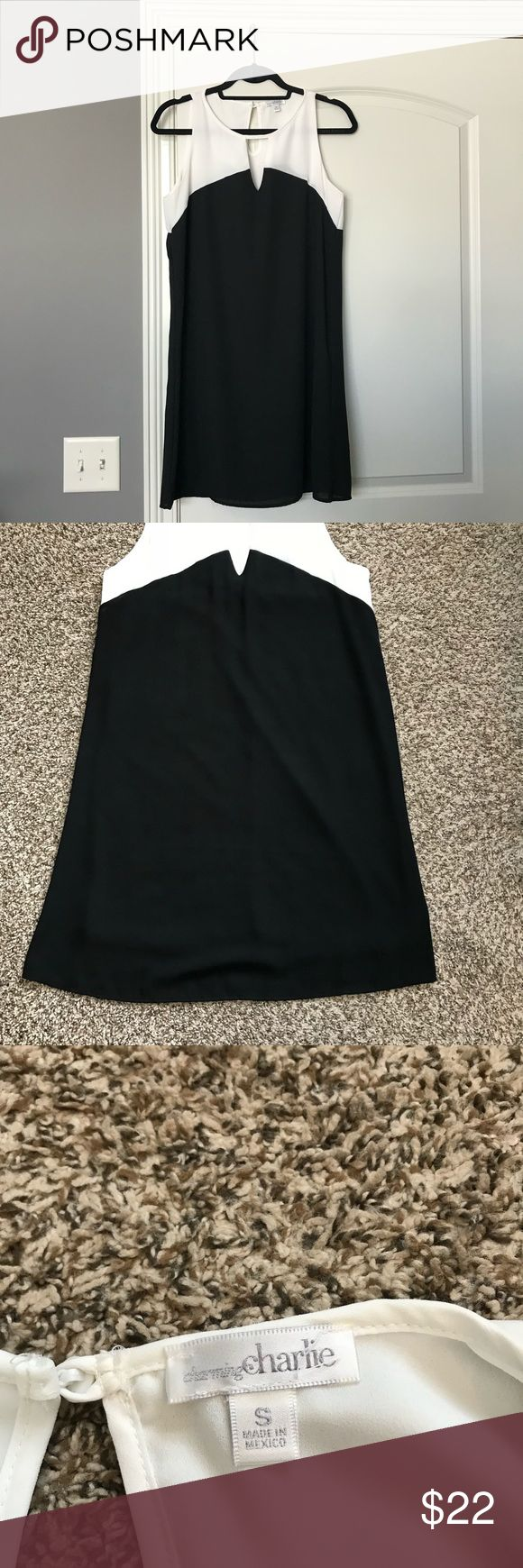Black and white dress Worn once! There is some fraying on the back of dress pictured. Great for any occasion. Key hole on front and back Charming Charlie Dresses