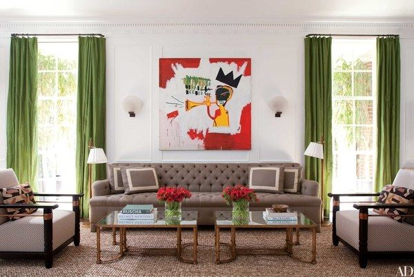 Designer Peter Dunham worked with film producer Steve Tisch on the redecoration of his 1932 Paul Williams house in Beverly Hills. Basquiat's Trumpet is displayed above a custom-made sofa in the living room; the cocktail tables are vintage French, and the 1940s floor lamps are by Jacques Adnet.