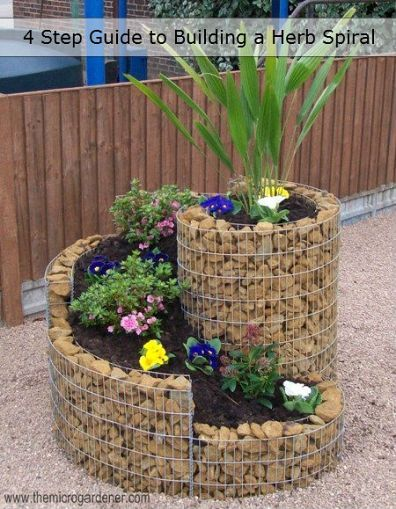 Spiral fence planter.  Interesting idea.  I'm not sure I would use rocks.