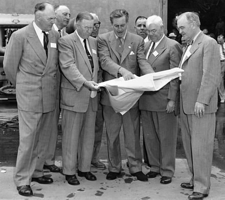 Disney shows the plans of Disneyland to officials from Orange County in December 1954