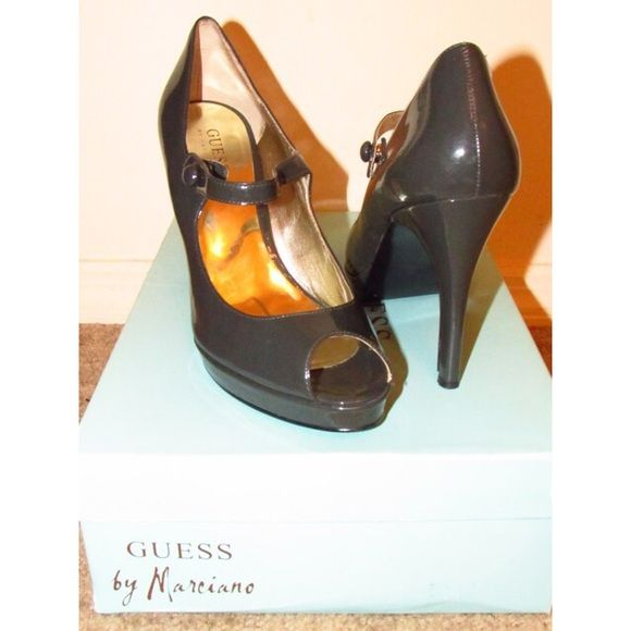 GUESS by Marciano Pumps Simple grey pumps that have a strap across the doors for ultimate comfort! Size US 8.5 and is perfect with any outfit! Only worn twice with slight creasing by the end of strap but isn't noticeable. Guess by Marciano Shoes Heels
