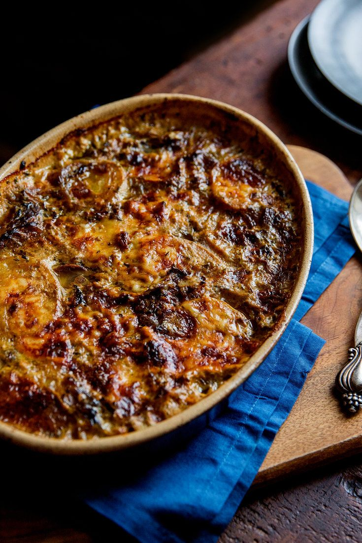 Wild mushrooms add a luxurious dimension to this comforting, almost classic potato gratin There is no cream here, just milk mixed with porcini broth (the result of soaking dried porcinis for 30 minutes in boiling water) You can use a mix of wild mushrooms, or just one type