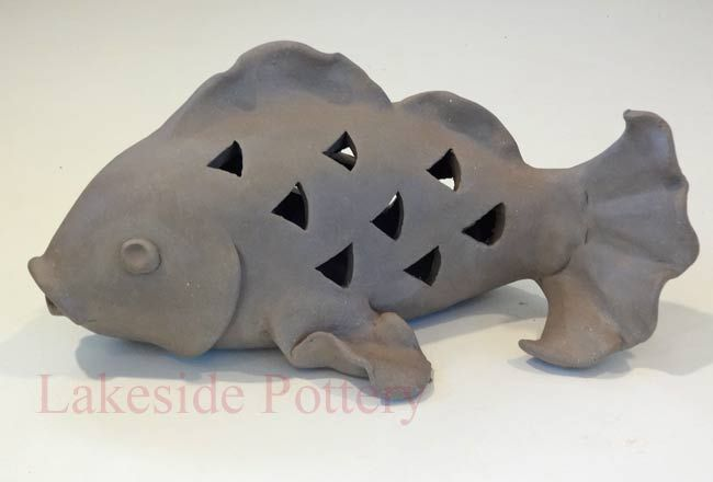 http://www.lakesidepottery.com/Media/JPG_Images/handbuilding-projects-ideas/fish-carved-lantern.jpg