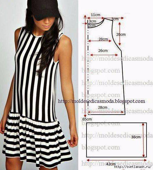robe trapèze sans manche ayant le haut qui descend jusqu'au hanche RAYE BLANC PUR ET NOIR FONCE VERTICALEMENT suivi d'une jupe trapèze RAYE HORIZONTALEMENT