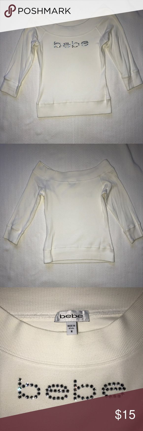 "Early Xmas sale 🎄❗️BEBE WHITE sweater Size M. Gently used BEBE white sweater. Size L, sweater measures 16in"" from top of chest to bottom of shirt. Bottom measures 13in"" in width. BEBE sizes run small this sweater will fit a size S or M in tops. Stretchy material. 😀 bebe Sweaters Crew & Scoop Necks"