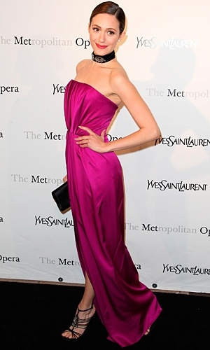 Emmy Rosum stood out from the crowd in the Metropolitan Opera Party in Yves Saint Laurent's signature magenta shade.