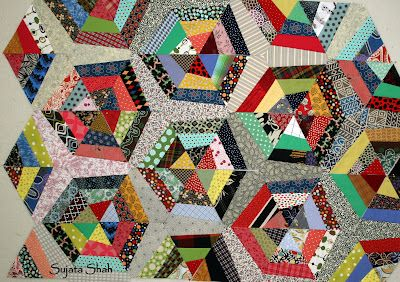 Fan blades among the spider webs - Sujata gives options for paper piecing three versions of this quilt