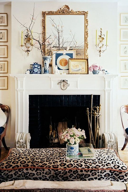 venetian mirror* gold leaf accents* animal print* black & white fireplace*