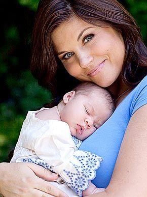 Brady Smith and Tiffani Amber Thiessen - FamousFix.com
