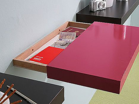awesome idea for a hidden storage space within a floating shelf