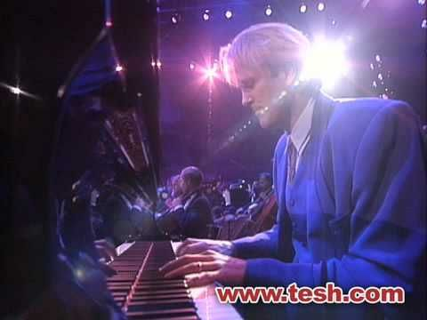 Barcelona • John Tesh • Live at Red Rocks 1995.  Also used in an olympic pairs skating routine