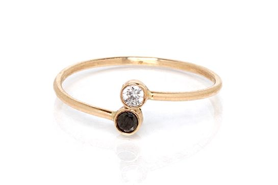 14k gold ring with a bezel set 3pt black diamond and white diamond stacked on…