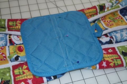 pinning the hanging potholder dish towel