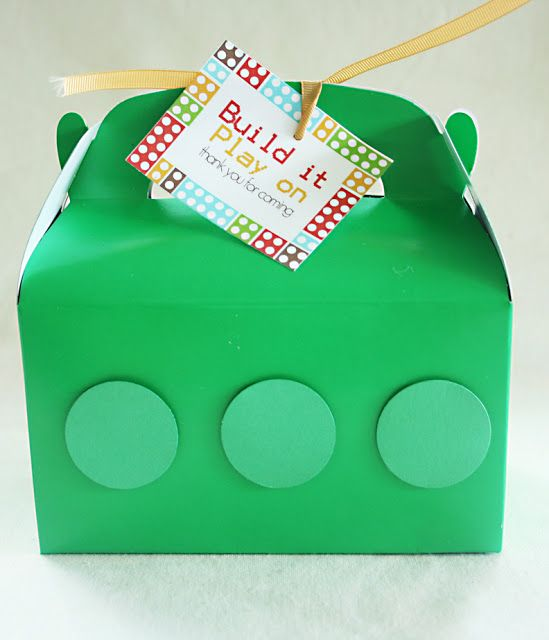 """Darling Darleen: Lego Party: Party Favors. The lego party favors were kept simple since we had a pinata and a mini candy bar for the kids at the party.  I bought treat boxes from oriental trading.  Similar to the party invitations, I punched three 1.5"""" diameter circles out of similar colored paper and affixed with foam sticker to the box for the lego block look."""