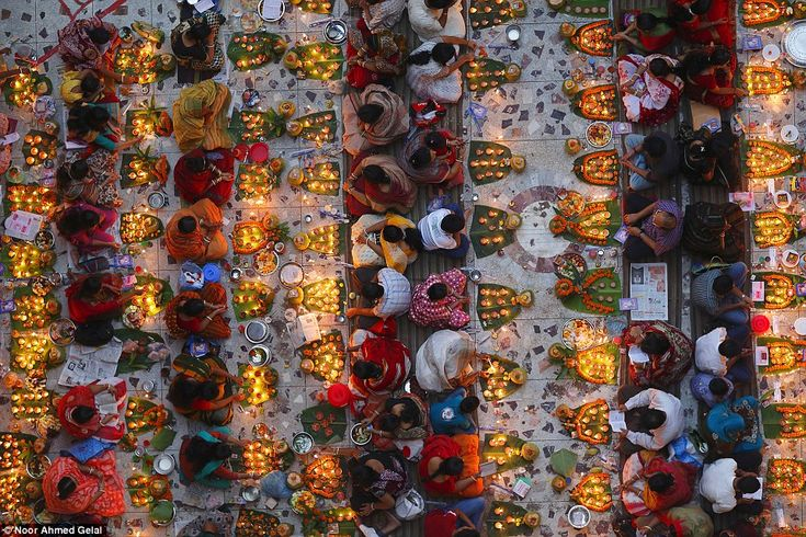 Open colour - Honourable mention: Shwamibagh temple, Bangladesh, by Noor Ahmed Gelal. 'The Hindu community celebrating the three-day Rakher Upabas festival at Loknath Temple in Barodi, near Dhaka. Devotees offer prayers after lighting earthen lamps and fast until the lamps have burned out'
