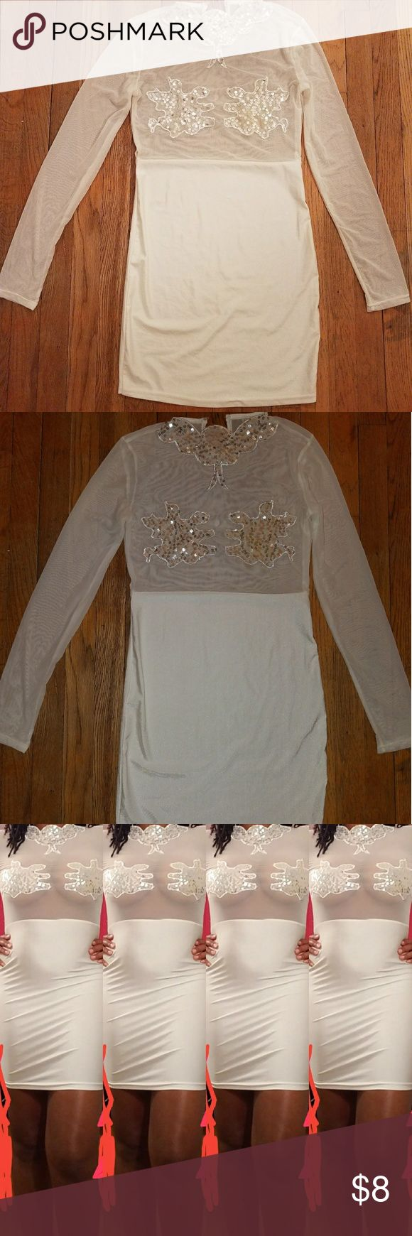 Used white mesh dress Used white mesh dress..size large..it has sequins in the neck area and around the chest area..you will need to add a button on the closing part in the back Dresses