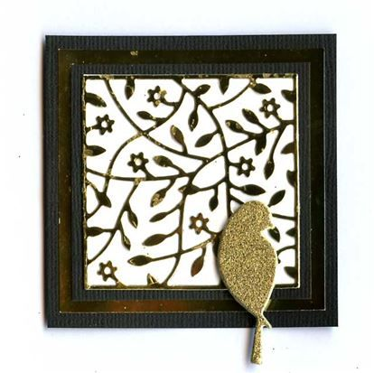 Memory Box - Tremaine Square cut from gold mirri card  and Poppystamps Peaceful Bird cut from gold glitter card.