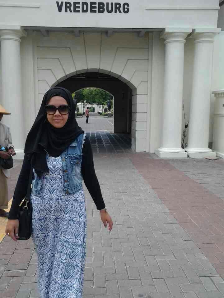 Denim vest, black hijab, blue pattern dress
