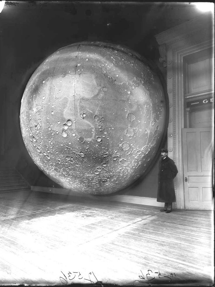 Security guard with plaster, wood, and metal moon model at the Field Museum of Natural History. (1898)