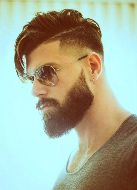 Men's haircut, long on top, tapered on sides with long beard, aviator sunglasses and earrings