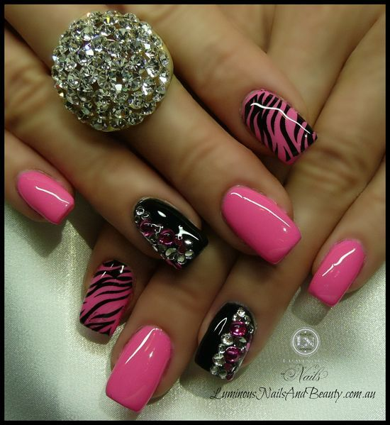 Pink zebra print + black with crystals nail art #nails #zoya #OPI #glitter #Tips #acrylicnails #acrylic #nails #fingernails #nailpolish #fingernailpolish #manicure #fingers #hands #prettynails #naildesigns #nailart #pedicure #hands #feet #opipolish #zoya #zoyanailpolish #naillacquer #pink #zebra #rhinestones