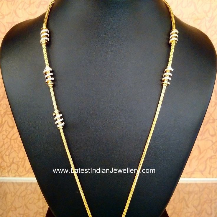 Latest thaali chain designs in unique look with spiral design mogappu on the side studded with CZs and Swarovski crystals in colorful combination stones