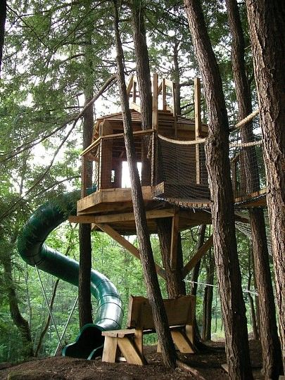 A tree house with a slide. I remember that when I used to play in my tree house, every time my mom called me..I wished I had a slide so I could go fast and not get in trouble :)