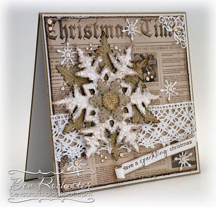 [Bev-Rochester-Tim-Holtz-layered-snowflake-2%255B2%255D.jpg]. Tim Holtz Layered Snowflake Die and embossing folder. I cut and embossed it in kraft and also white cardstock, then slathered on the glitter, glitter flakes and stickles.  I finished it off with a SB snowflake and a bead-type button which started off life clear but I coloured it (and the clear rhinestone flatbacks with E44 copic marker).
